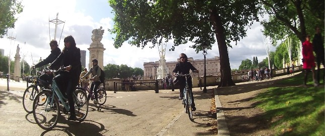 Cycling by Buckingham Palace